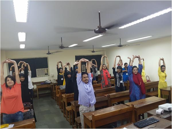 Faculties and Student-Teachers doing the asanas together
