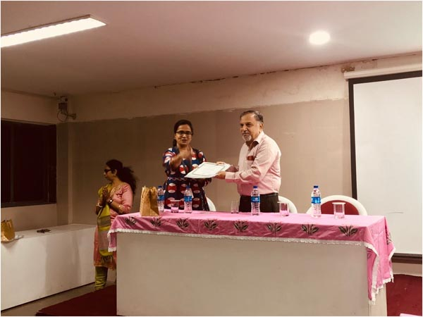 Our Principal, Dr. Radhika Vakharia handing over a token of appreciation to Mr. Gandhi