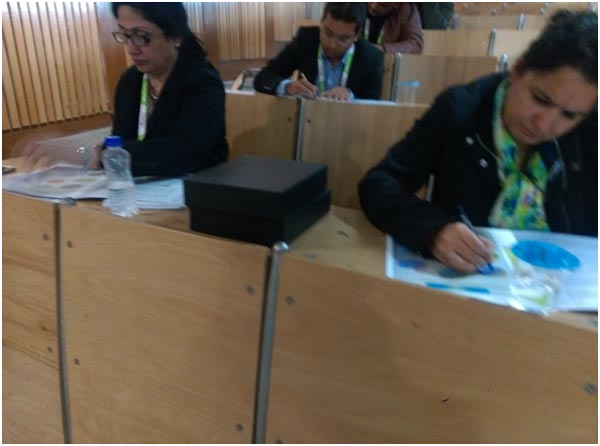 Participants keenly filling the activity sheets during the workshop