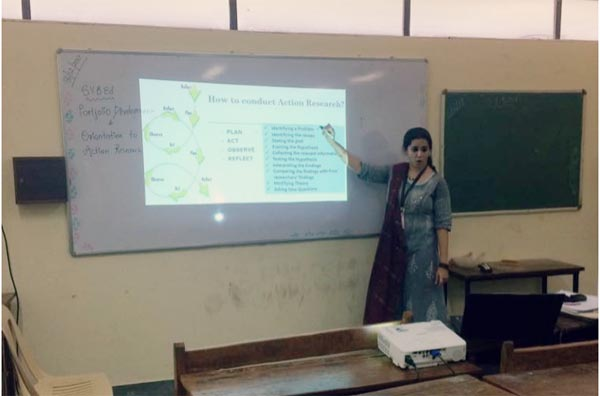 Mrs. Pooja Manghirmalani Mishra orienting the students on Action Research