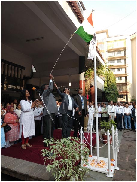 Principal, Dr Vakharia and Dr. Paul hoisting the National Flag