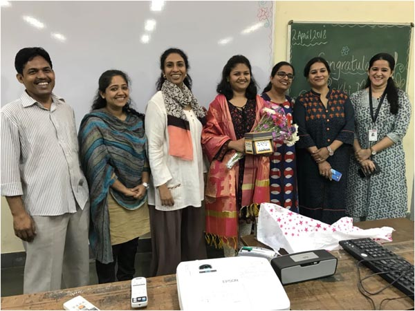 All teachers and Principal Ma'am of RCOEd felicitating Dr. Rakhi