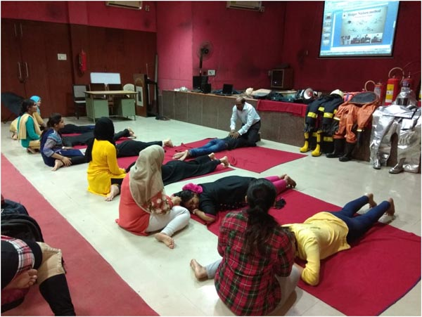 Student teachers being trained for CPR and Artificial Breathing